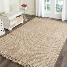 Add a rustic look to your home or office decor with this jute rug. Hand made from high quality natural jute, this beautiful rug will enhance any space. Primary materials: Jute Latex: No Pile height: 0 Natural Jute, Colorful Rugs, Natural Jute Rug, Natural Fiber Rugs, Rugs, Braided Area Rugs, Jute Area Rugs, Fringe Rugs, Sisal Rug