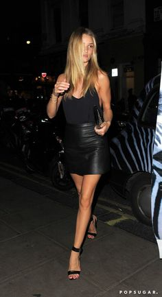 Pin for Later: Styling Hacks to Steal From the Best Model Off-Duty Moments  Rosie Huntington-Whitelely was minimalist chic and totally sexy in a slinky black tank, leather miniskirt, and ankle-strap heels for a night out.