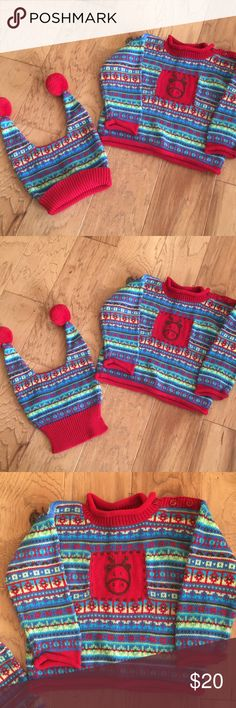 Hanna Andersson Christmas sweater &hat sz 80 (2) Such a sweet little sweater and hat set from Hanna Andersson size 80 (2T/ 3T). Excellent preowned condition with no piling or stains. I don't think my son ever had the chance to wear this adorable set.  Too many clothes and such little time!  Comes from a pet and smoke free home. Please see my other listings and feel free to make an offer on a bundle for great deals and combined shipping! Hanna Andersson Shirts & Tops Sweaters