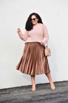 Girl With Curves blogger Tanesha Awasthi wearing a pleated Satin Skirt and sweater.