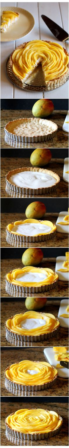 This easy Mango Tart recipe looks super impressive, but comes together easily! It's also Gluten Free, Paleo, Vegan, and Refined Sugar Free | from Bakerita.com