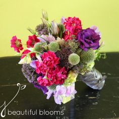 Bridesmaid's bouquet of purple trichelium, thistle, sweet peas, lisianthus, stock and green hydrangea by Beautiful Blooms by Jen.
