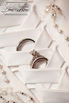 Wedding - Bride & Groom's rings in the back of the Bride's dress