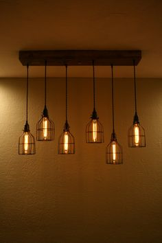 Easy Install 36 Linear Wood Mount - 6 Cage Chandelier Wood mount measures 36 x 6 x 2.5 Includes: 6 Cage Light Pendant Strands - all with a