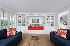 Image from http://pin-insta-decor.com/wp-content/uploads/2016/07/Built-in-daybeds-living-room-beach-style-with-red-pillows-tongue-and-groove-built-in-bench.jpg.