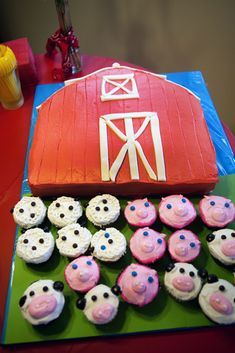 Farm-themed birthday party with barn cake and animal cupcakes