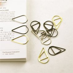 Find More Bookmark Information about 10 pcs/pack Brief Style Waterdrop Shaped Metal Paper Clip Bookmark Stationery School Office Supply Escolar Papelaria,High Quality stationery machine,China stationery paper supplies Suppliers, Cheap supply vessel from house of novelty Store on Aliexpress.com