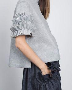 Ruffles make the Sleeve in this sweatshirt and ruffle-flap denim skirt. Sweatshirt Refashion, Sweatshirt Dress, Casual Outfits, Fashion Outfits, Fashion Trends, Sleeves Designs For Dresses, Fashion Details, Fashion Design, Sweat Shirt