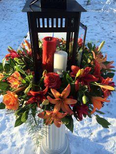 Outdoor Winter Wedding Lantern arrangement with lilies and roses #flowers #winter #wedding #florist #bridal | Pod Shop Flowers Wedding Designs