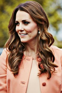 i love the coral, and how she's gone for the curly look.  reminds me of a curling rod, if i may say so myself!