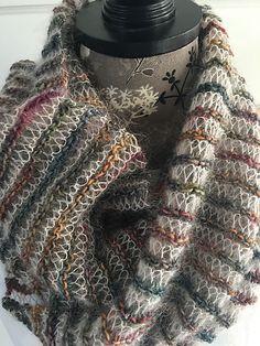 Ravelry: Twisted Lacey Scarf pattern by Caroline Kerr