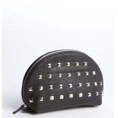 Wyatt black studded faux leather cosmetic case set NWT Wyatt black studded faux leather 2 in one cosmetic cases. You will receive 2 bags. Zip closure. Measures Approximately: Large Case 10'' Wide X 6'' Tall X '' Deep 3½ Small Case: 9'' Wide X 6'' Tall X 3'' Deep Wyatt Bags Cosmetic Bags & Cases