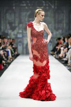 Pavoni. Stunningly beautiful red couture gown. One shouldered, sheer under and beaded overlay.  Ruffled accents.