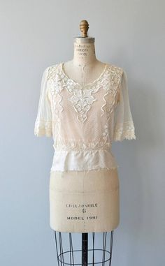 Antique late Edwardian and early 1920s silk net and lace blouse with applique lace and short sleeves. --- M E A S U R E M E N T S ---  fits like: small shoulder: 15 bust: 34-36 waist: 31 length: 20 brand/maker: n/a condition: very good, slight underarm discoloration & raw bottom hem  ➸