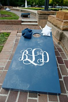 Wedding cornhole set. Wedding planner: The Graceful Host Weddings and Event. Venue: Mint Museum - Randolph. Photography: The Beautiful Mess