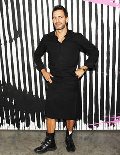Marc Jacobs in a black button-down shirt paired with black boots