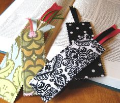 Fabric bookmarks via 7 Layer Studio (http://7layerstudio.typepad.com/7_layer_studio/2008/09/scrap-savvy-bookmark-tutorial.html)