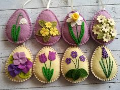 Felt Easter decoration - purple lilac felt eggs with spring flowers including primroses, violet flowers, grape hydrangea, tulips, daffodils and other flowers. Listing is for 8 ornaments: - Primroses on lilac background - Snowbell on lilac background - Daffodil on lilac background - Tiny