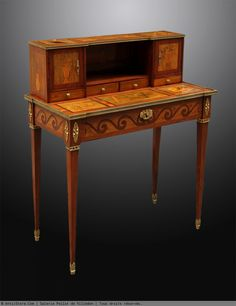A Louis XVI Bonheur du jour By Charles Topino Bonheur du jour By Charles Topino Based on thin legs. It opens with a wide frieze drawer and two doors enclosing a niche and revealing a small shelf and three small drawers in front of the upper part. Fully decorated with fine marquetry attributes arts and games - painting, literature and card games on wooden background satinwood green stained in rosewood frames and nets Amarante. The doors and sides of the step are inlaid flower vases. Belt…