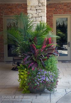 Awesome landscaping and container gardening design.   Unique by Design l H. Weis