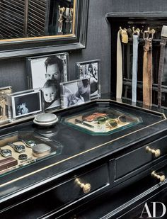 A large photograph of Kopelman with Olive—the elder of his and wife Drew Barrymore's two daughters—is displayed on the dressing room's chest of drawers; the vitrine trays store vintage Rolexes, cuff-link boxes, and small mementos.