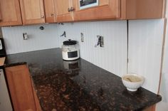 Beadboard backsplash  Hot glue makes it temporary & easily removable.