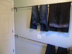 Great idea to use stacked curtain rods as a drying rack. Great for pants!