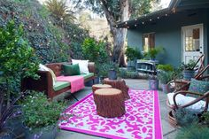 Summertime extends your living space into the outdoors, and offers an opportunity to take risks with your decor. This hot pink rug is a choice that rewards. The juxtaposition against this yard's natural elements is pleasingly electric. $37 - $115, etsy.com