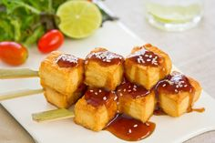 http://ift.tt/2hNJXU1  The Grilled Tofu and Spicy Plum Barbeque Sauce is a healthy and delicious appetizer that you can serve for your parties. The plum sauce is a versatile sauce that you can use as a dip in curries or even as a sauce for Barbeques. Tofu is also a very versatile cheese that absorbs the blends of the various spices from the plum sauce making it a delicious appetizer for parties.  Ingredients  Ingredients for the Plum Sauce  3 pounds red plums pitted and chopped3 cloves…