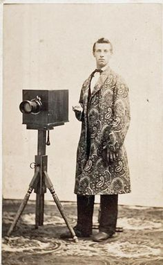 1860s wet-plate photographer in paisley wrapper.