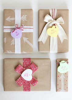 {Candy Heart Tags}  Polymer clay sweets look just like the real thing. The tags are such a fun compliment to handmade arrow and dot kraft gift wrap that's tied with red and white ribbon and twine