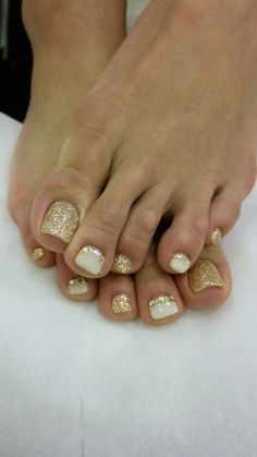 nails. i like the white and gold glitter combo. might try as gel nails.. by sonalsogani