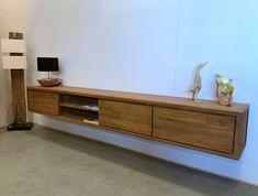 Wauw wat is die mooi! dit zwevende tvmeubel van 3 meter breed van teak. Om het meubel te bevestigen aan de muur zit er een houten balk bijgeleverd. Die monteert u aan de muur en daar kunt u het meubel weer aan ophangen. Voor dit fraaie teakhouten tv meubel wordt uitsluitend de beste kwaliteit gerecycled teakhout gebruikt. De laden gaan gemakkelijk open op rails. Ook leverbaar in 200cm breed. Entryway Tables, Cabinet, Storage, Furniture, Home Decor, Clothes Stand, Purse Storage, Decoration Home, Room Decor