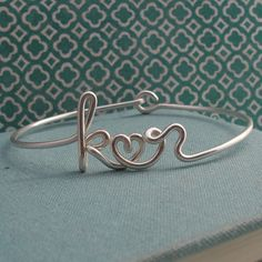This would look awesome with my cape cod bracelets! b <3 t   Two Lovers Bracelet in Sterling silvercustom 2 by Laladesignstudio, $75.00