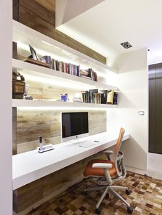 Small-Space Workstation    Under-shelf lighting instantly enhances this small-space workstation. The horizontal shelves in a glossy white finish add a crisp look with modern, minimalist appeal. Design by Ilija Karlusic