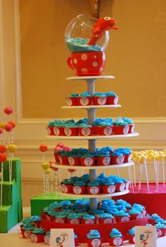 Make this Cat in the Hat cupcake tower for your Dr. Seuss baby shower or first birthday party Dr Seuss Party Ideas, Dr Seuss Birthday Party, Twin Birthday Parties, Baby Birthday, Birthday Party Themes, Birthday Ideas, Dr Seuss Baby Shower Ideas, Birthday Cupcakes, Dr Seuss Graduation Party
