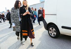 Stella Greenspan in Converse sneakers, and Selby Drummond in a Salvatore Ferragamo coat and Gucci shoes