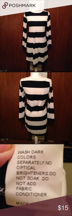 Navy and White Dress Navy and white striped dress. Bet soft and comfortable. 95%Polyester 6% Spandex. Excellent Condition. Barely worn. Dresses Midi