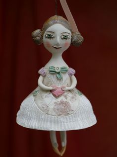 Young girl in a dress with ornament, bell doll, small ceramic sculpture.  Valentine's day