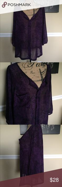 Purple Torrid Blouse This is a purple & black sheer blouse from Torrid. It is size 3/3x. It has pockets on chest & it's in excellent condition. ((Will be adding better pictures tomorrow)) torrid Tops