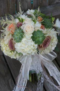 By Dew Drop Flower Shoppe in Seville Ohio. Wedding flowers; roses, hydrangea, freesia, snapdragon, succulent.