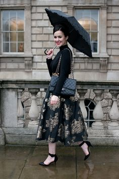 The 20 Best Street Style Looks from London Fashion Week, Fall 2014: Arabella Golby (Zara top and shoes, Chanel bag and earrings, H&M belt, New Look umbrella)