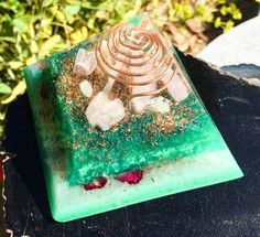A Violet Flame Orgone Pyramid to open the Heart Chakra and let love flow in your life. Rose Quartz, Kunzite, Morganite and Aventurine direct