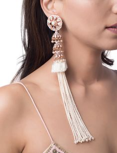 The heritage pearl tassel earrings are infused with quintessential Indian-ness and modern eccentricity. The statement pair of earrings feature the borla embellished with crystal zirconias, small jhumkis with crystal baguettes, delicate silk and pearl tass Stylish Jewelry, Cute Jewelry, Luxury Jewelry, Fashion Jewelry, Jewlery, Long Tassel Earrings, Bridal Earrings, Jewelry Design Earrings, Designer Earrings