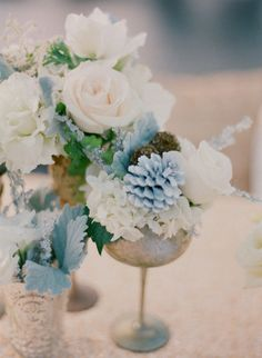 centerpieces :trios of vintage vases filled with blue succulents, seasonal greenery and foliages, gray dusty miller, blush spray roses, fresh lavender, scabiosa pods, Queen Ann's lace, ivory garden roses, and pink astrantia.