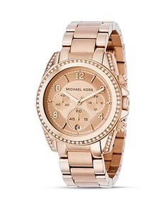 my husband made me open one of my Christmas gifts last night.  It was this- Michael Kors Rosegold Watch.  LOVE IT!