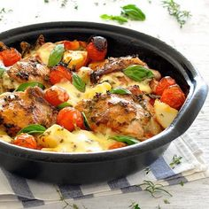 Italian Baked Chicken with Potatoes and Cherry Tomatoes Recipe Main Dishes with chicken thigh fillets, olive oil, crushed tomatoes, cherries, potatoes, mozzarella cheese, pepper, salt, thyme leaves, rosemary leaves, garlic cloves, red wine vinegar, extra-virgin olive oil, salt, black pepper