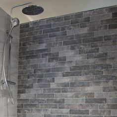Brick slips are a simple, cost-effective way of creating an eye-catching feature wall. Using brick slips will reduce the time and stress of creating featured walls.  Jerica Brick Slip is the embellishment your project needs. These stunning porcelain brick-effect tiles can create a wondrous feature wall to round off your garden patio with panache.   Due to their super strong and hardwearing porcelain composition, these tiles can withstand everything our not so stunning climate can throw at… Brick Effect Tiles, Brick Tiles, Brick Bonds, Bathroom Wall, Bathroom Ideas, Outdoor Material, Splashback, Rustic Kitchen, Earthy