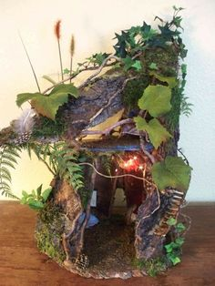 Fairy House - cute little 2-story interior and exterior fairy house - doesn't look weatherproof, but very cute, with the open side walls it would be easy to look into the interior but it still LOOKS like a house - inspiration only (so far, when I have time I'm going to try to find sources for these indulgy pins)  ***********************************************   via indulgy #fairy #house #garden t√