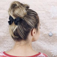 Knotted bun chignon with a bow by Kayley Melissa